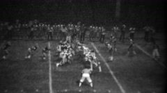 1978: High school football night game receiver diving catch fail. - stock footage