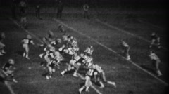 1978: High school football night game running back gets 1st down. - stock footage
