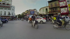 Person cross the road in Ha Noi, point of view video, Vietnam Stock Footage