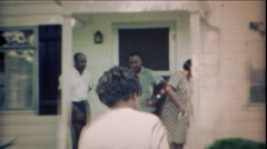 1969: Happy African family meeting outdoor home front porch. - stock footage