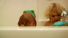 Little Boys Playing In Bathtub At Bath time Stock Footage