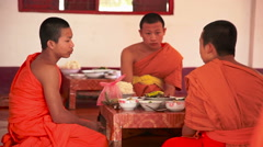 Monks have lunch at the table in  monastery. Luang Prabang city, Laos Stock Footage