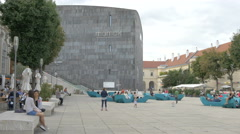 Tourists relaxing near Mumok art museum in Vienna Stock Footage