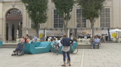 Mother with daughter and other tourists relaxing in Museumsquartier, Vienna Stock Footage