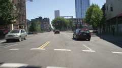 Front view of a Driving Plate: Car travels east on West Burnside Street in Stock Footage
