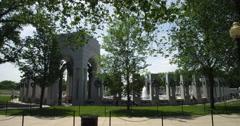 World War II Memorial behind trees, Washington DC. Shot in May 2012. - stock footage