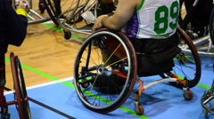 Basketball players in a wheelchair during a dead time a basketball game Stock Footage