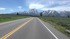 Driving POV towards Grand Teton NP Mountains HD Stock Footage