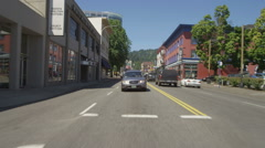 Rear view of a Driving Plate: Car travels east on West Burnside Street in Stock Footage