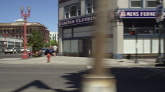 Left Side view of a Driving Plate: Car travels east on West Burnside Street in Stock Footage