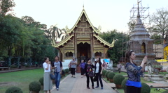People at Wat Phra Singh in Chiang Mai Stock Footage