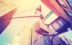 Vintage stylized photo of pedestrian traffic lights in Manhattan, NYC, USA. - stock photo