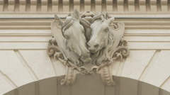 Two horse head sculptures on Kunsthalle Wien building, Vienna Stock Footage