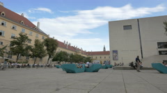 People relaxing near Leopold Museum in Vienna Stock Footage