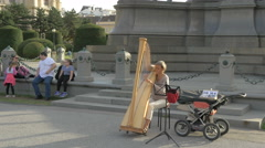 Woman playing a harp near Maria Theresa Monument, Vienna Stock Footage