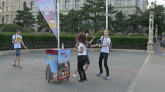 Four people dancing in Maria-Theresien-Platz, Vienna Stock Footage