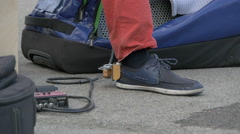 Fuss percussion attached to the musician's shoe performing in Vienna - stock footage