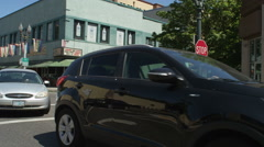 Left Rear Three Quarter view of a Driving Plate: Car travels south on Broadway Stock Footage