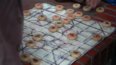 Close up shot of hands playing board game in park Stock Footage