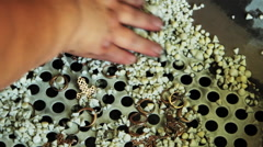 The cup and the process of polishing gold jewelry. Stock Footage