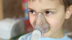 Child Breathes Into The Inhaler - stock footage