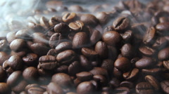 Fresh roasted coffee beans letting off steam as they cool down. - stock footage