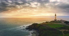 Aerial view of Pigeon Point Lighthouse and Pacific Ocean at sunset. California Stock Footage