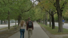 Couple walking in a park in Prater, Vienna - stock footage