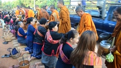 Monk walking on the road for people pray and put food offerings at morning Stock Footage