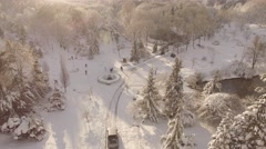 Aerial shot of a snowy park and the forest during winter in Istanbul Stock Footage