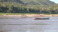 Slow boat on Mekong river at Luang Prabang city Stock Footage