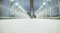 Slow people walking on a modern walkway bridge in the city Stock Footage
