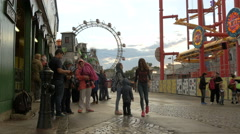 Tourists standing next to the Boomerang, in Prater, Vienna - stock footage