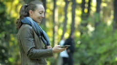 Young Girl Writes SMS in The Park Stock Footage