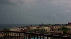 Man on the balcony overlooking the sea is a storm and lightning in Egypt Stock Footage
