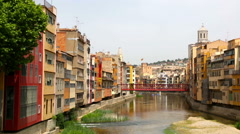 River and picturesque homes in Girona Stock Footage