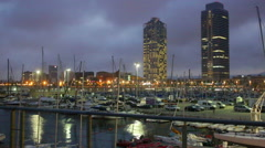 Night view of skyscrapers and port Stock Footage