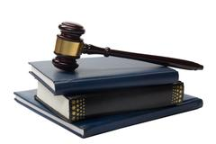 Law book with a wooden judges gavel on table in courtroom Stock Photos
