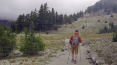 Hiker on mountain trail Stock Footage