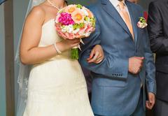 nice wedding bouquet in bride's hand - stock photo