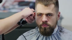 Barber Cuts the Hair in the Barbershop Stock Footage