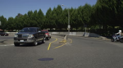 Left Side view of a Driving Plate: Car turns left out of Legacy Emanuel Hospital Stock Footage