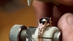 Manual setting of the precious stones in jewelry. Stock Footage