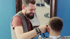 Friendly hairdresser doing hairstyle bearded man Stock Footage