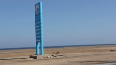 Stand with Fuel Prices near the Sea next to the Dog and the Eagle, Egypt Stock Footage
