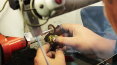 Brushed gold jewelry on a grinding wheel. Stock Footage