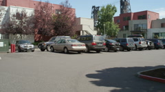 Left Rear Three Quarter view of a Driving Plate: Car turns right onto NW Naito Stock Footage