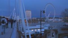 Golden Jubilee Bridge and London Eye in the evening - stock footage