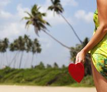 red heart on exotic sandy beach - Valentine's day concept - stock photo
