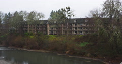 Zoom-in on guest rooms at the rear of a hotel beside the river in Grants Pass, Stock Footage